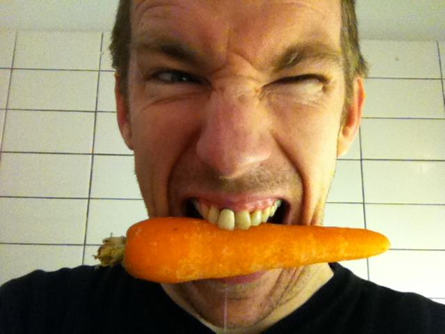 Man bits carrot